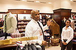 Brooks Brothers employees talk in the store located in the South Atrium in the Hartsfield–Jackson Atlanta International Airport, in Atlanta, Georgia on August 28, 2013.