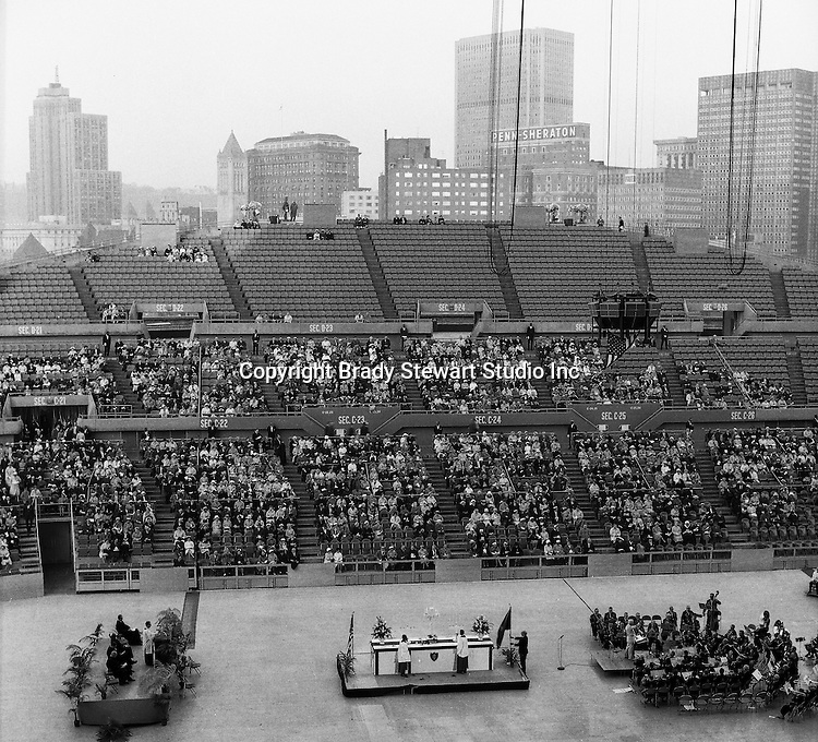 Pittsburgh PA:  On location photography for the Council of Churches. Easter Sunrise Service, the Civic Arena roof was open for services - 1963. The Council of Churches was a merger of three local groups; Allegheny County Sabbath School Association, the Pittsburgh Council of Churches and the Council of Weekday Religious Education.  The council's objection was to better relate and understand other religions including the local Jewish, African American, Catholic and Christian churches in the downtown Pittsburgh area.