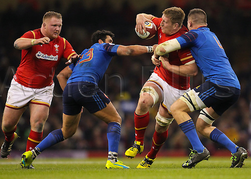 26.02.2016. Principality Stadium, Cardiff, Wales. RBS Six Nations Championships. Wales versus France. Wales Bradley Davies gets tackled by France's Paul Jedrasiak
