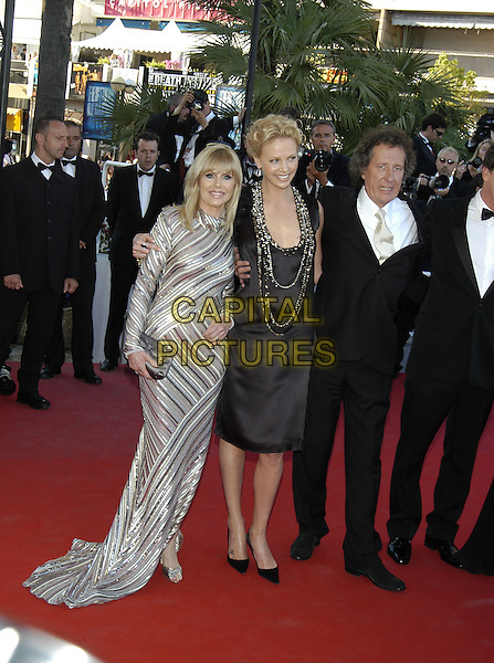 "BRIT EKLAND, CHARLIZE THERON & GEOFFREY RUSH.Arrivals at screening of ""The Life and Death of Peter Sellers"".Cannes Film Festival, France 21st May 2004..full length long sleeved tight silver striped dress black dress low cut plunging neckline with silver gold stones beading.sales@capitalpictures.com.www.capitalpictures.com.©Capital Pictures"