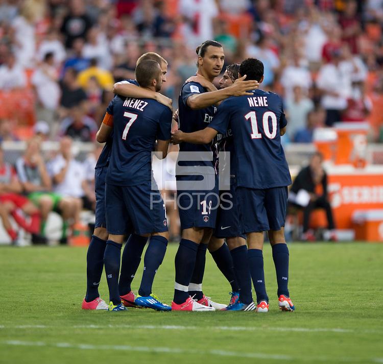 Zlatan Ibrahimovic (18) of Paris Saint-Germain FC celebrates his goal with teammates during the game at RFK Stadium in Washington, DC.  Paris Saint-Germain FC tied D.C. United, 1-1.