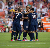 Zlatan Ibrahimovic (18) of Paris Saint-Germain FC celebrates his goal with teammates during the game at RFK Stadium in Washington, DC.  Paris Saint-Germain FC tied D.C. United, 1-1.