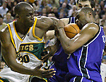 Seattle SuperSonics' Reggie Evans, L, tries to wrestle the ball away from Sacramento Kings' Kenny Thomas in the fourth period of their first round playoff game at Key Arena in Seattle, Washington Saturday, 23 April  2005. The Sonics beat the Kings 87-82.. Jim Bryant Photo. ©2010. All Rights Reserved.