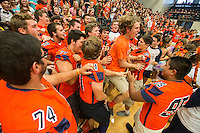 NWA Democrat-Gazette/ANTHONY REYES &bull; @NWATONYR<br /> Members of the Heritage football team jump and dance Friday, Sept. 25, 2015 during a pep rally at the school in Rogers. The event including the introduction of the 2015 homecoming court, musical performances, dancing and a pep rally for a football game against Springdale.