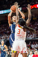 College Park, MD - DEC 29, 2016: Connecticut Huskies guard Saniya Chong (12) shots a jump shot over Maryland Terrapins guard Kaila Charles (3) during game between No. 1 UConn and the No. 3 Terrapins at the XFINITY Center in College Park, MD. UConn defeated Maryland 87-81. (Photo by Phil Peters/Media Images International)