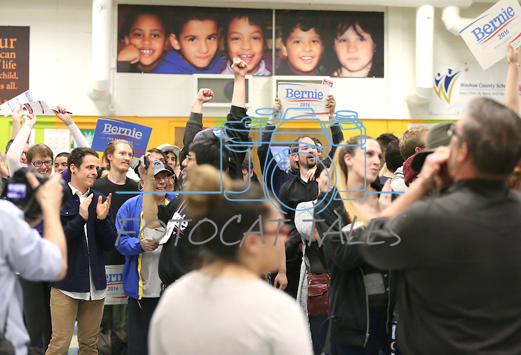 Bernie Sanders supporters celebrate after their precinct failed to come up with enough Hillary Clinton caucus votes during the Democratic Caucus at Libby Booth Elementary School, in Reno,  Nev. on Saturday, Feb. 20, 2016. Cathleen Allison/Las Vegas Review-Journal