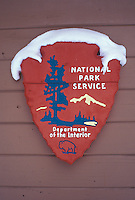 A snow-covered National Park Service sign on a building at Pictured Rocks National Lakeshore near Munising, Mich.