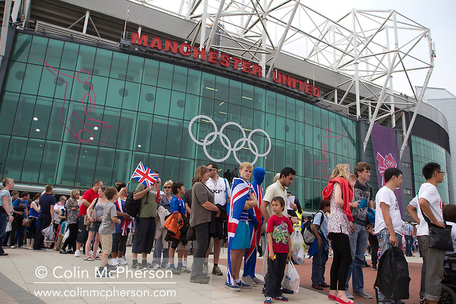 Spectators queueing for security checks outside Manchester United's Old Trafford stadium prior to the Men's Olympic Football tournament matches at the venue. The double header of matches resulted in Uruguay defeating the United Arab Emirates by 2-1 while Great Britain and Senegal drew 1-1. Over 72,000 spectators attended the two Group A matches.