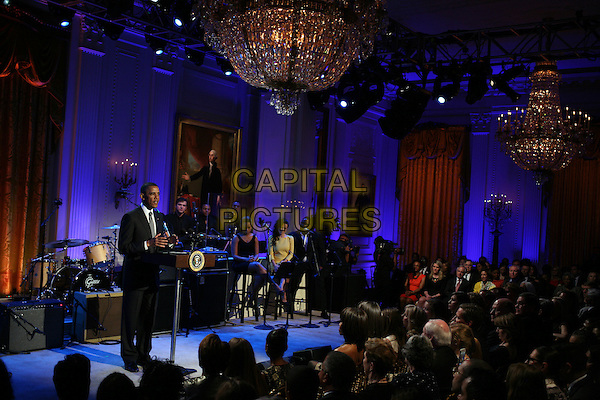"Sam Moore (left) and Joshua Ledet perform ""Soul Man"" for United States President Barack Obama (front row center) during a concert of Memphis Soul music as part of the ""In Performance at the White House"" series,  in the East Room of the White House in Washington, Tuesday, April 9, 2013.  .full length black suit podium speech.CAP/ADM/CNP/MS.©Martin Simon/CNP/AdMedia/Capital Pictures."