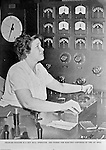 """Spokane Washington and McCook Illinois: View of Swindell-Dressler brochure highlighting the Electric Furnaces designed, constructed and installed in two Alcoa plants during World War II. The caption reads: Frances Higgins is a Hot Mill Operator and works the controls on the 120"""" mill."""
