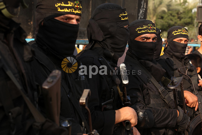 Palestinian Islamic Jihad militants stand guard during a rally marking the 29th anniversary of the movement foundation in Gaza City October 21, 2016. Photo by Ashraf Amra