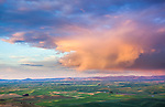 The Palouse, Whitman County, Washington: Clearing storm clouds at sunset over the rolling wheat fileds of the Palouse from Steptoe Butte State Park.