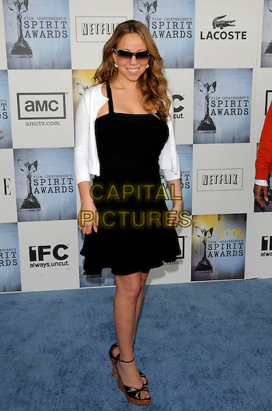 MARIAH CAREY.The 2009 Independent Spirit Awards in Santa Monica, California, USA. .February 21st, 2009 .full length black dress wedges sunglasses shades white cardigan cork ankle strap .CAP/DVS.©Debbie VanStory/Capital Pictures.