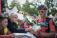 Olympic Champion &amp; overall kids hero Greg Van Avermaet (BEL/BMC) signing autographs to the many school kids that showed up at the start of the stage in Aalter (Belgium).<br /> <br /> 12th Eneco Tour 2016 (UCI World Tour)<br /> stage 4: Aalter - St-Pieters-Leeuw (202km)