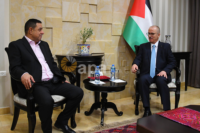 Palestinian Prime Minister, Rami Hamdallah, a head of the General Federation of Palestinian Communities in Europe Ali Al-Qadi, in the West Bank city of Ramallah, on December 31, 2018. Photo by Prime Minister Office