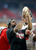 Ohio State Buckeyes running back Ezekiel Elliott (15) holds up the Fiesta Bowl trophy after beating Notre Dame Fighting Irish during the Fiesta Bowl in the University of Phoenix Stadium on January 1, 2016.  (Dispatch photo by Kyle Robertson)