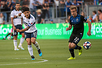 SAN JOSE, CA - AUGUST 24: Fredy Montero #12 of the Vancouver Whitecaps and Tommy Thompson #22 of the San Jose Earthquakes during a game between Vancouver Whitecaps FC and San Jose Earthquakes at Avaya Stadium on August 24, 2019 in San Jose, California.