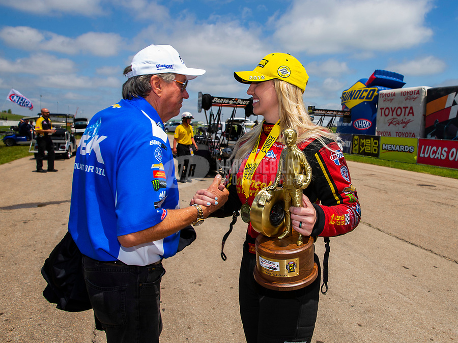 May 21, 2018; Topeka, KS, USA; NHRA funny car driver Courtney Force (right) celebrates with father John Force after winning the Heartland Nationals at Heartland Motorsports Park. Mandatory Credit: Mark J. Rebilas-USA TODAY Sports
