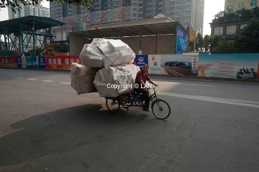 A Man On A Bike With Boxes in Dongguan, China.  © LAN