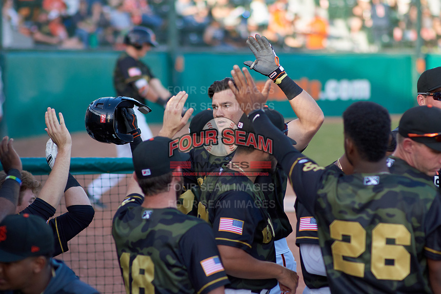 San Jose Giants first baseman Gio Brusa (17) is congratulated by teammates after hitting his first home run of the season during a California League game against the Visalia Rawhide on April 13, 2019 at San Jose Municipal Stadium in San Jose, California. Visalia defeated San Jose 4-2. (Zachary Lucy/Four Seam Images)