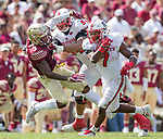 North Carolina State running back Nyheim Hines picks up extra yardage as teammate tackle Will Richardson blocks Florida State defensive back Derwin James in the second half of an NCAA college football game in Tallahassee, Fla., Saturday, Sept. 23, 2017.  NC State defeated Florida State 27-21. (AP Photo/Mark Wallheiser)