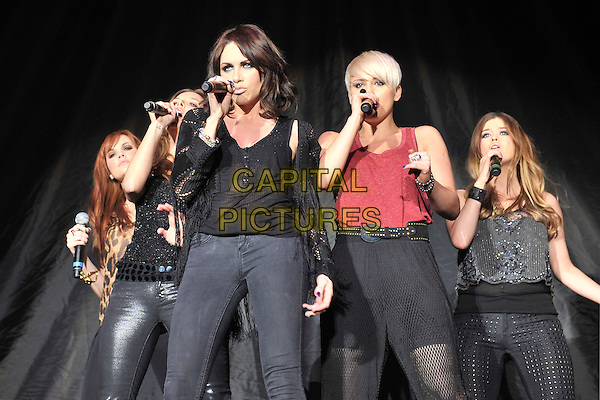WONDERLAND - Corrina Durran, Jodi Albert, Sharon Condon, Kasey Smith & Leigh Learmint.Performing live at Wembley Arena, London, England..February 26th, 2011.stage concert live gig performance music full length black top jacket jeans denim singing 3/4 half leggings pink top singing .CAP/MAR.© Martin Harris/Capital Pictures.