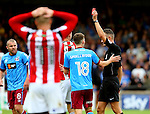 Chris Basham of Sheffield Utd receives a red card during the English League One match at Glanford Park Stadium, Scunthorpe. Picture date: September 24th, 2016. Pic Simon Bellis/Sportimage