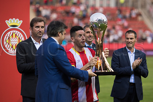 August 15th 2017, Estadi Montilivi, Girona, Spain; Pre Season Football Friendly, Girona versus Manchester City; Girona CF Captain picks up the Costa Brava Trophy