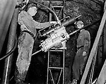West Virginia - View of men working in a coal mine and using Joy Mining Equipment - 1958