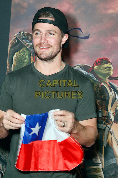 PHILADELPHIA, PA - JUNE 2 :  ***HOUSE COVERAGE***  Special Guest Stephen Amell (The CW&rsquo;s &ldquo;Arrow&rdquo;) picturedl walking the red carpet and introducing his new film, Teenage Mutant Ninja Turtles at UA Riverview in Philadelphia, Pa on June 2, 2016  <br /> CAP/MPI/STA<br /> &copy;STA/MPI/Capital Pictures