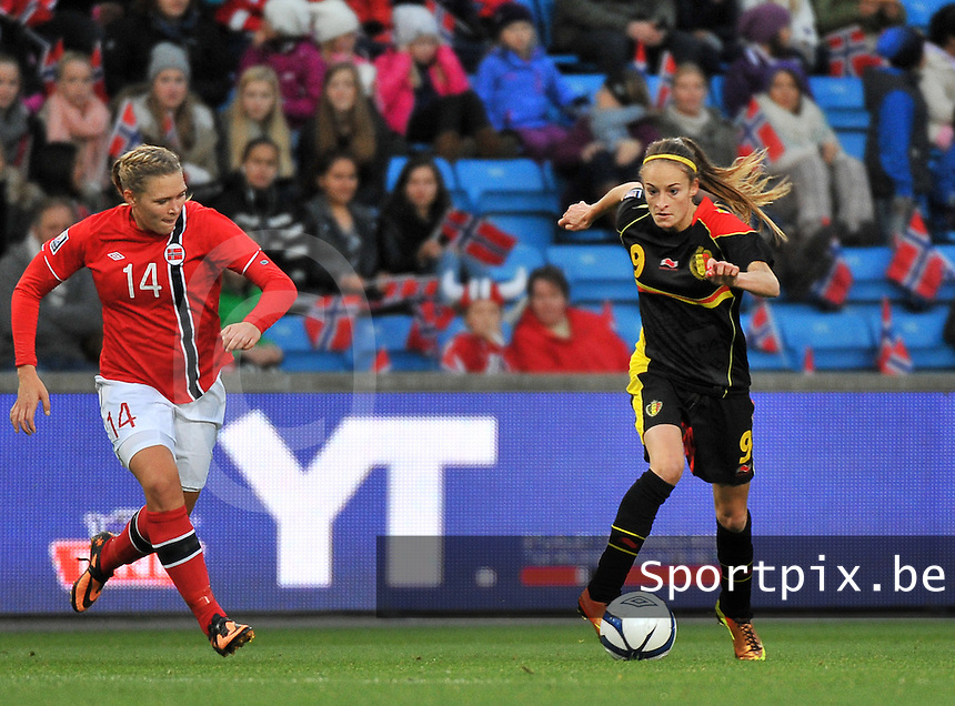 20130925 - OSLO , NORWAY : Belgian Tessa Wullaert (9) pictured with Norwegian Ingvild Isaksen (14)  during the female soccer match between Norway and Belgium , on the second matchday in group 5 of the UEFA qualifying round to the FIFA Women World Cup in Canada 2015 at the Ullevaal Stadion , Oslo . Wednesday 25th September 2013. PHOTO DAVID CATRY
