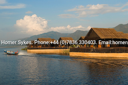 Inle Lake. Myanmar (Burma.) 2006. Tourists leave their hotel complex built in the lake by boat.
