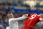 Norway's Kjetil Waehler challenges Wales Steve Morison..Wales v Norway Vauxhall international friendly match at the Cardiff City Stadium in South Wales..Editorial use only.