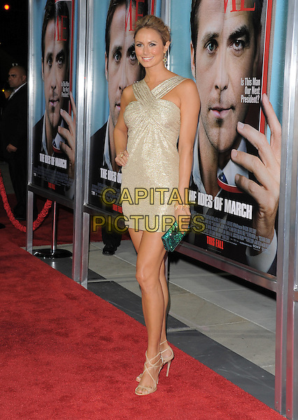 Stacy Keibler.The L.A. Premiere of 'The Ides of March' held at The Academy of Motion Picture Arts & Sciences  in Beverly Hills, California, USA..September 27th, 2011.full length dress green clutch bag hand on hip beige silver gold  .CAP/RKE/DVS.©DVS/RockinExposures/Capital Pictures.