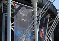 Pictured: Workers in abseiling gear install a banner outside the National Stadium of Wales (aka Principality Stadium) Thursday 25 May 2017<br />Re: Preparations for the UEFA Champions League final, between Real Madrid and Juventus in Cardiff, Wales, UK.