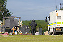 Army Bomb Disposal team are seen inthe grounds of St. Coleman's Cemetery, Lurgan, Monday, June 17th, 2019. (Photo by Paul McErlane for the Belfast Telegraph) Army Bomb Disposal team are seen inthe grounds of St. Coleman's Cemetery, Lurgan, Monday, June 17th, 2019. (Photo by Paul McErlane)