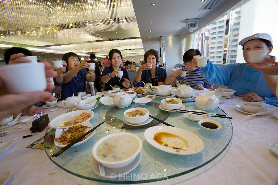 China, Hong Kong S.A.R..Dim Sum at Choi Fook Royal Banquet Causeway Bay at Windsor House, which is also used for wedding banquets later in the day.