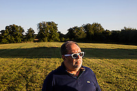 Dr. Amjad Bahnassi is the Chairman of the Board of the Islamic Society of Greater Worcester, seen here in Dudley, Massachusetts, on Tues., Aug 23, 2016, on a plot of land that the Islamic Society is trying to buy to create a Muslim cemetery for the community. The nearest Muslim cemetery is in Enfield, Connecticut, and many of the group's relatives are buried there. The group is looking for a place closer to Worcester to bury their loved ones but has encountered substantial opposition from locals and town officials. Bahnassi is a psychiatrist and Medical Director of Behavioral Healthcare Services and in Worcester, Massachusetts. He is a Syrian immigrant who arrived in Worcester in 1983 for a residency at the University of Massachusetts. He became an American citizen in the late 1980s. His son is buried in the Enfield, Connecticut, Muslim cemetery, and he says the distance to that cemetery makes it difficult to visit his son's gravesite as often as he would like. He believes Dudley locals' fear of and bigotry toward Muslims is driving opposition to the proposed cemetery.