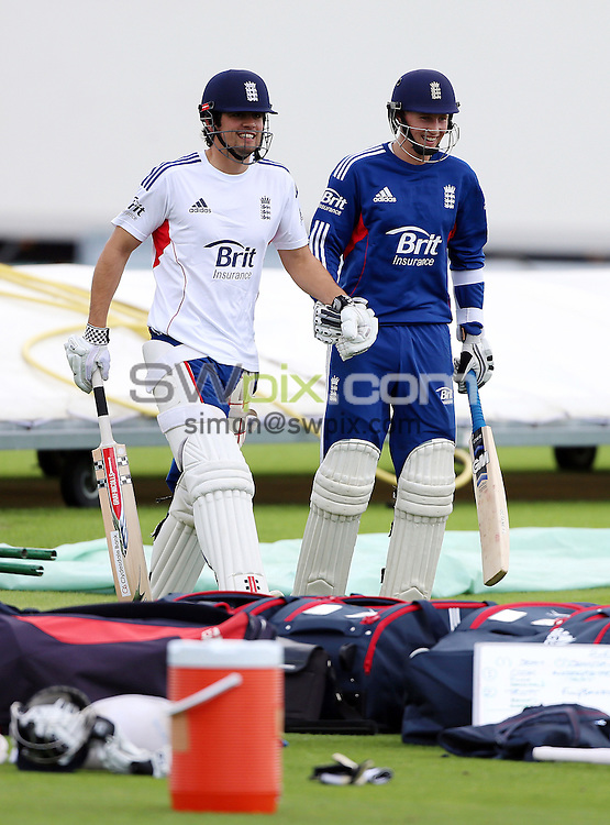 PICTURE BY VAUGHN RIDLEY/SWPIX.COM - Cricket - England v New Zealand, 2nd Test - England Nets - Headingley, Leeds, England - 22/05/13 - England's Alastair Cook and Joe Root have a laugh jumping and skipping towards the nets.