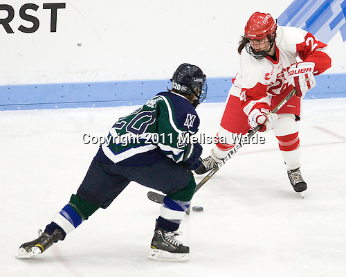 Meghan Corbett (Mercyhurst - 20), Taylor Holze (BU - 24) - The Boston University Terriers defeated the visiting Mercyhurst College Lakers 4-2 in their NCAA Quarterfinal matchup on Saturday, March 12, 2011, at Walter Brown Arena in Boston, Massachusetts.