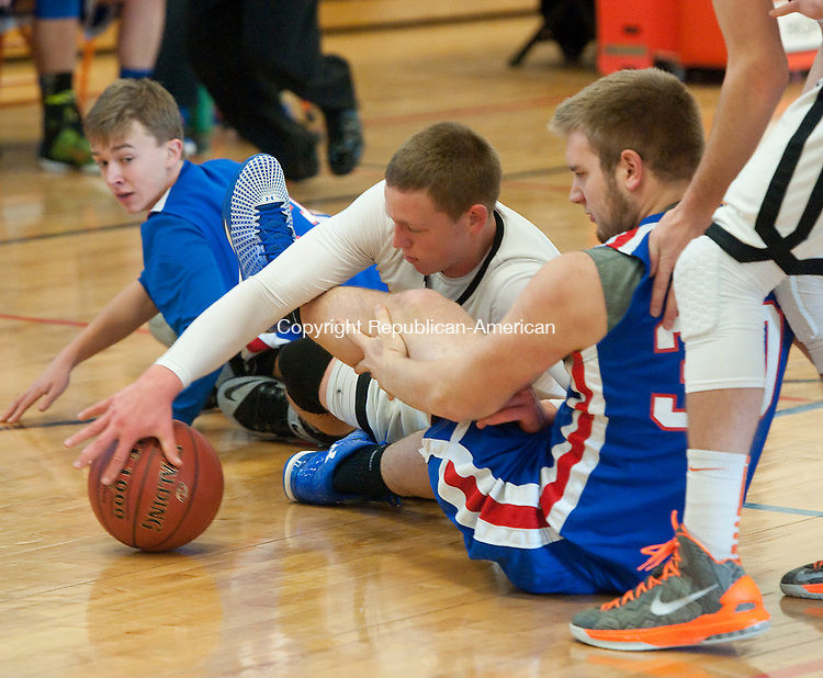 WATERTOWN,  CT-013115JS06-  Watertown's Zachary Kopp  (10) battles for a loose ball with Nonnewaug's Nathan Firlings  (33) and Nicholas DeCicco  (31) during their game Saturday at Watertown High School.<br /> Jim Shannon Republican-American