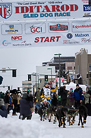 Andy Pohl and team leave the ceremonial start line with an Iditarider and handler at 4th Avenue and D street in downtown Anchorage, Alaska on Saturday March 3rd during the 2018 Iditarod race. Photo ©2018 by Brendan Smith/SchultzPhoto.com
