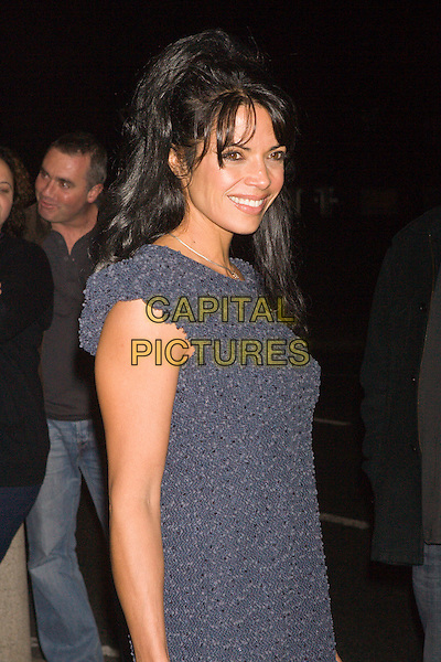 JENNY POWELL.The Nolans in concert, Manchester Apollo Theatre, Manchester, England. .October 13th, 2009.half length blue grey gray dress.CAP/AT.© Alan Towse/Capital Pictures.