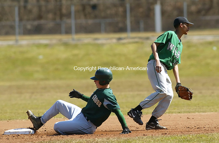 WATERBURY, CT 4/14/07- 041407BZ03- Holy Cross's Matt Mancuso (3) slides safely into second as Wilby's Kevin Romero (2) waits for the ball Saturday morning.<br /> Jamison C. Bazinet Republican-American