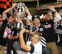 Owner Will Chang of D.C. United celebrate their win with the trophy and fans over Real Salt Lake at the U.S. Open Cup Final on October  1, 2013 at Rio Tinto Stadium in Sandy, Utah. DC United beat Real Salt Lake 1-0 to win the championship.