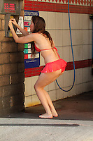 Alicia Arden<br /> washes her car at a self-wash facility while wearing a bikini, West Hollywood, CA 04-26-15<br /> David Edwards/Dailyceleb.com 818-249-4998
