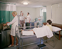 Rest Haven Nursing Home nurse with a patient in the physical therapy room.
