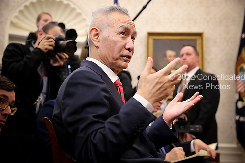 Vice Premier Liu He of the People's Republic of China He speaks during a meeting with United States President Donald J. Trump in the Oval Office of the White House on January 31, 2019 in Washington, DC. <br /> Credit: Oliver Contreras / Pool via CNP