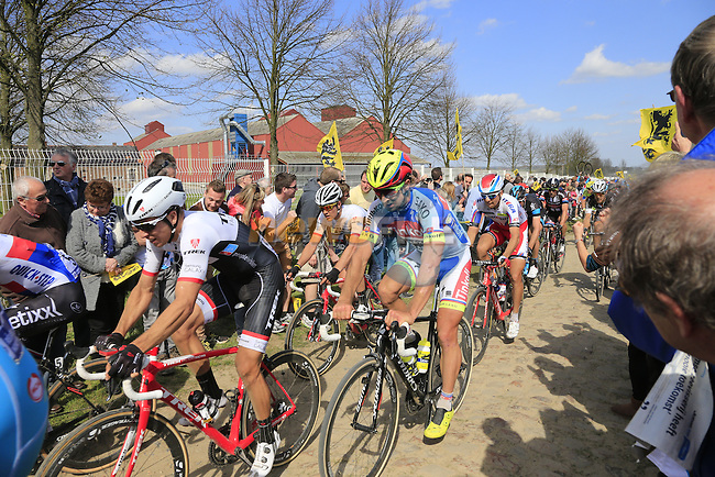 The peloton including Peter Sagan (SVK) Tinkoff-Saxo tackle Sector 10 Mons-en-Pevele during the 113th edition of the Paris-Roubaix 2015 cycle race held over the cobbled roads of Northern France. 12th April 2015.<br /> Photo: Eoin Clarke www.newsfile.ie