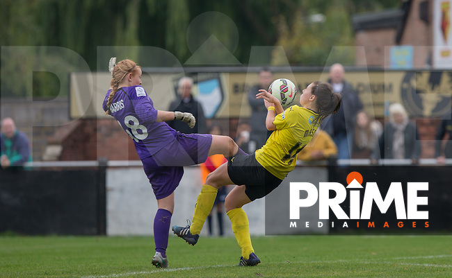Goalkeeper Sophie Harris of London Bees beats Ellie Mason of Watford Ladies to the ball hitting her full in the face in the process during the final FAWSL2 match of the 2015 season between Watford Ladies and London Bees at Berkhamsted FC, Berkhamstead, England on 18 October 2015. Photo by Andy Rowland.